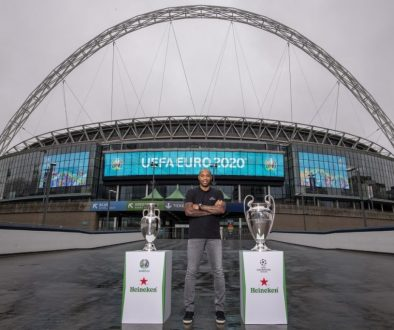 Henry with EURO and UCL Trophy with Wembley arch backdrop 2
